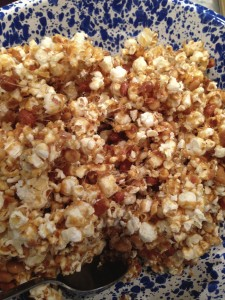 Mixing the caramel in with the popcorn